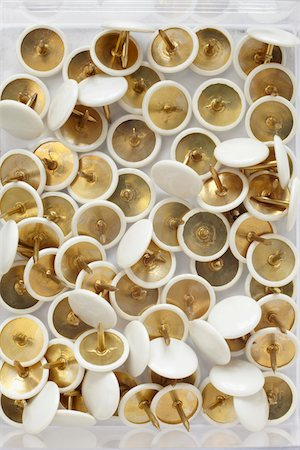 close-up of group of white and gold thumbtacks Stock Photo - Rights-Managed, Code: 700-06701947