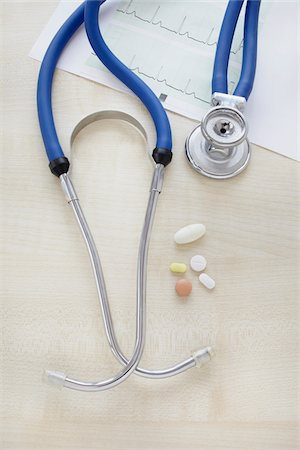 close-up of a stethoscope, an electrocardiogram report and pills Stock Photo - Rights-Managed, Code: 700-06701942