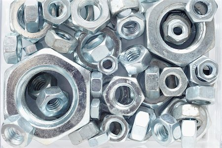 Close-Up of Silver Colored Metal Nuts Stock Photo - Rights-Managed, Code: 700-06701955