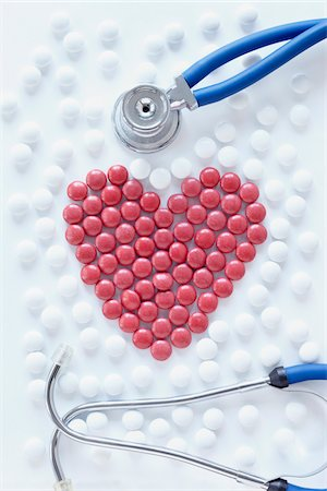close-up of red pills arranged into heart shape with stethoscope Stock Photo - Rights-Managed, Code: 700-06714048