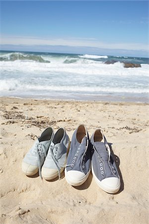 Two Pairs of Blue Sneaker Shoes at the Beach Stock Photo - Rights-Managed, Code: 700-06714056