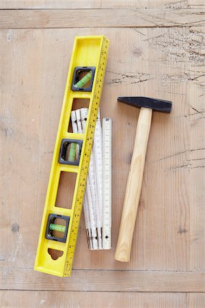 still life of tools, hammer, bubble level, and folding meter stick Stock Photo - Rights-Managed, Code: 700-06714097