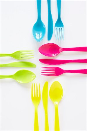 still life of colored plastic cutlery laid out in sets Stock Photo - Rights-Managed, Code: 700-06714093