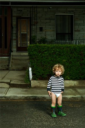 Boy Standing on Neighbourhood Street in Diaper and Rubber Boots Stock Photo - Rights-Managed, Code: 700-06758130