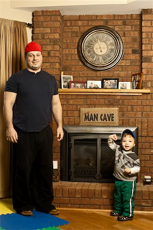 decorations - Father and Son Standing by Fireplace in Man Cave Stock Photo - Rights-Managed, Code: 700-06758132