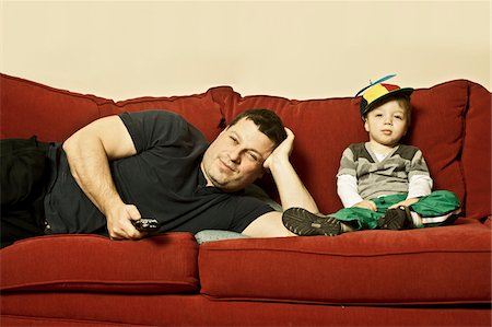 people - Father and Son watching TV Stock Photo - Rights-Managed, Code: 700-06758133