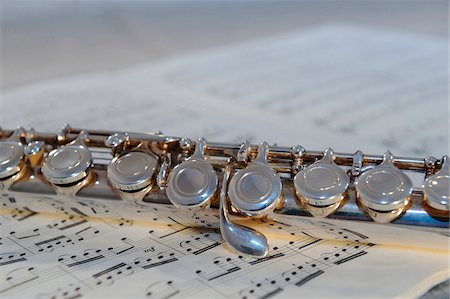 sheet music - Western concert flute on sheet music Stock Photo - Rights-Managed, Code: 700-06752068