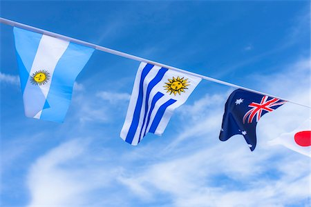 Uruguayan, Argentinian, Australian, and Japanese flags against blue summer sky Stock Photo - Rights-Managed, Code: 700-06752247