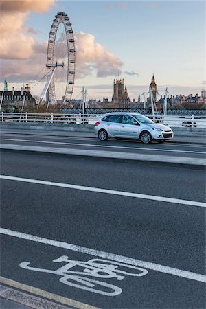 Car parked on Waterloo Bridge with view of the London Eye and The Houses Of Parliment in the background. Wesminster, London, UK Stock Photo - Rights-Managed, Code: 700-06752257