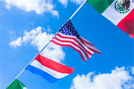 Mexican, American, and Dutch flags against blue summer sky Stock Photo - Rights-Managed, Code: 700-06752250