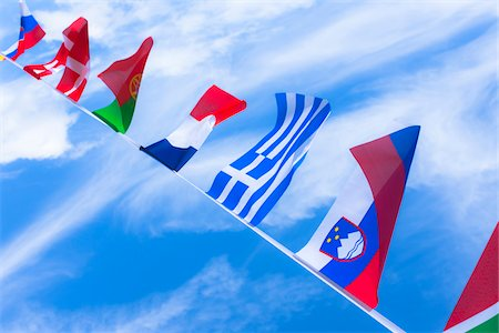 Slovenian, Greek, French, Portuguese, Danish, Swiss, and Slovakian flags against blue summer sky Stock Photo - Rights-Managed, Code: 700-06752261