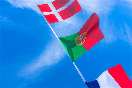 portuguese (places and things) - Danish, Portuguese, and French flags against blue summer sky Stock Photo - Rights-Managed, Code: 700-06752263