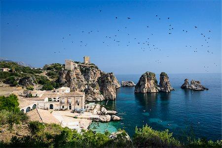 Italy, Sicily, Trapani district, Scopello, Tonnara and faraglioni (stack rocks) Stock Photo - Rights-Managed, Code: 700-06752317