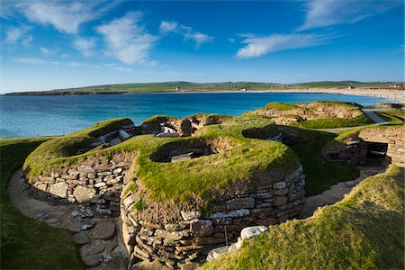 Scotland, Orkney Islands, Skara Brae Prehistoric Village, a stone-built Neolithic settlement, located on the Bay of Skaill on the west coast of Mainland Orkney. It forms part of the Heart of Neolithic Orkney World Heritage Site. Stock Photo - Rights-Managed, Code: 700-06773280