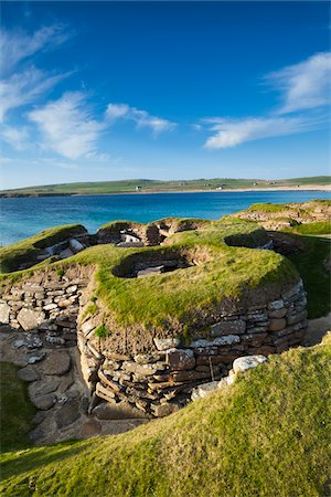 Scotland, Orkney Islands, Skara Brae Prehistoric Village, a stone-built Neolithic settlement, located on the Bay of Skaill on the west coast of Mainland Orkney. It forms part of the Heart of Neolithic Orkney World Heritage Site. Stock Photo - Rights-Managed, Code: 700-06773281