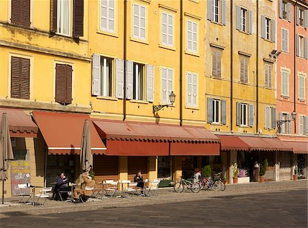 outdoor cafe and colourful buildings lining courtyard in Modena Italy Stock Photo - Rights-Managed, Code: 700-06773315
