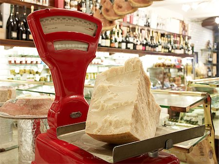 supermarket not people - large wedge of parmesan cheese on red antique weigh scale in specialty meat and antipasto shop, Modena, Italy Stock Photo - Rights-Managed, Code: 700-06773319