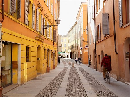 street - quaint cobblestone street with pedestrians and bicyclists, Modena, Italy Stock Photo - Rights-Managed, Code: 700-06773310