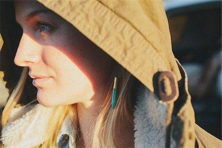 Close-up of Young Woman Wearing Jacket Hood Stock Photo - Rights-Managed, Code: 700-06786685