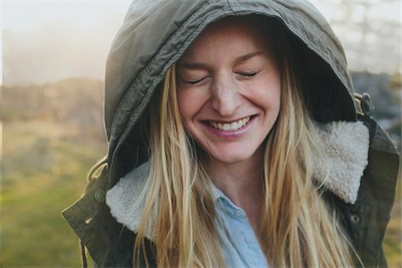 Cute young woman wearing a hood and laughing in Hood River Oregon. Stock Photo - Rights-Managed, Code: 700-06786687