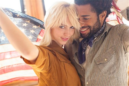 Couple wrapped in an American flag, Portland Oregon USA Stock Photo - Rights-Managed, Code: 700-06786688