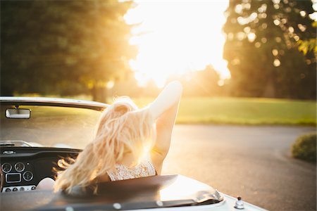 rear - Teenage girl in a 1966 Triumph with hair blowing wind in Portland Oregon. Stock Photo - Rights-Managed, Code: 700-06786689