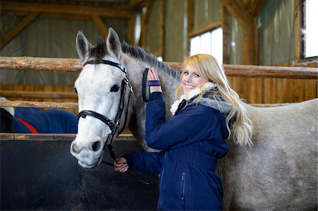 Young Woman grooms a Half Arabian Quarterhorse in his stable, Bavaria, Germany Stock Photo - Rights-Managed, Code: 700-06786882
