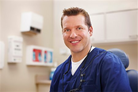 Portrait of male dentist seated in a chair in an examination room. Stock Photo - Rights-Managed, Code: 700-06786925