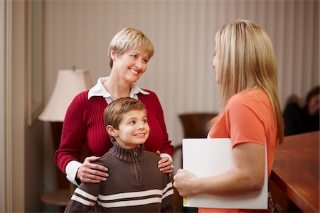 Young boy with mother being greeted by dental hygienist at dentist office Stock Photo - Rights-Managed, Code: 700-06786949