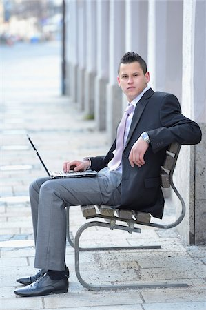 Young Businessman with Laptop Sitting on Bench, Bavaria, Germany Stock Photo - Rights-Managed, Code: 700-06786957
