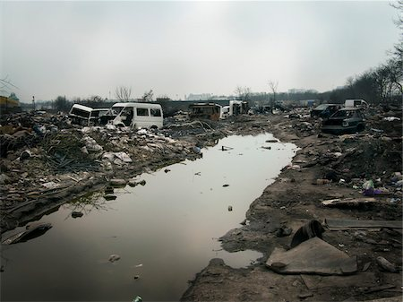 Burnt out wasteland now occupied by travellers, Saint Denis, France Stock Photo - Rights-Managed, Code: 700-06808746