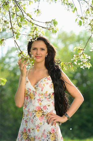 Portrait of a young woman standing beside a flowering cherry tree in spring, Germany Stock Photo - Rights-Managed, Code: 700-06808867
