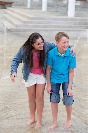 Boy and Girl Playing in a Fountain Together Stock Photo - Rights-Managed, Code: 700-06808957