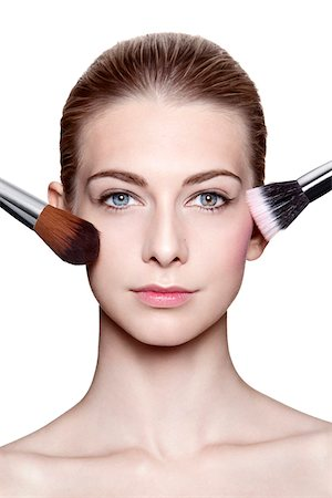 Close-Up of Young Woman Applying Make-Up with Brushes on White Background Stock Photo - Rights-Managed, Code: 700-06826407