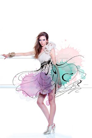 Young Woman Fashion Model Posing in Dress with Illustrated Embellishments Stock Photo - Rights-Managed, Code: 700-06826415