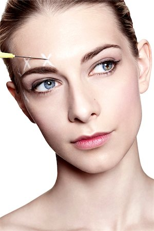 Close-Up of Young Woman with Face Marked for Beauty Injections Stock Photo - Rights-Managed, Code: 700-06826410