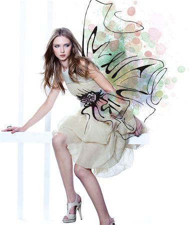 Young Woman Fashion Model Wearing Dress with Embellishment Illustration of Bow Stock Photo - Rights-Managed, Code: 700-06826412