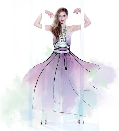 Young Woman Fashion Model Wearing Dress with Illustrated Embellishments Stock Photo - Rights-Managed, Code: 700-06826413