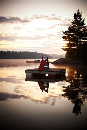 Slide on Floating Dock in Morning, Riley Lake, Muskoka, Northern Ontario, Canada. Stock Photo - Rights-Managed, Code: 700-06841598