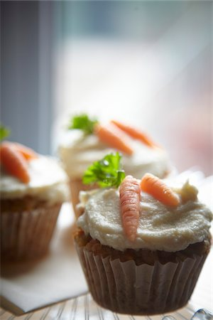 food - carrot muffins with cream cheese icing and marzipan carrot decorations Stock Photo - Rights-Managed, Code: 700-06841605