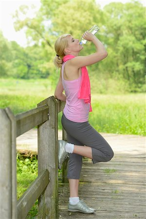 Blond athletic woman drinking water from bottle outdoors, Germany Stock Photo - Rights-Managed, Code: 700-06899966
