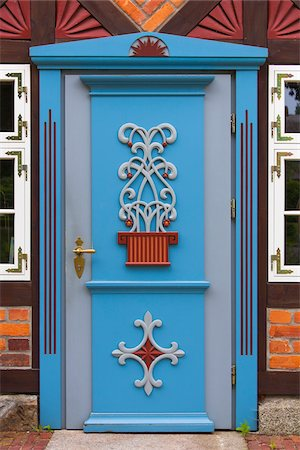 design (motif, artistic composition or finished product) - Frame house with ornate door, Born, Fischland-Darss-Zingst, Coast of the Baltic Sea, Mecklenburg-Western Pomerania, Germany, Europe Stock Photo - Rights-Managed, Code: 700-06892497