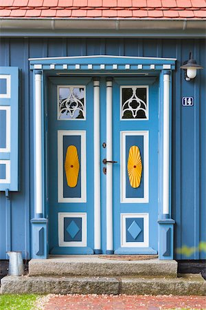 quaint house - Traditional ornate door in Born, Fischland-Darss-Zingst, Coast of the Baltic Sea, Mecklenburg-Western Pomerania, Germany, Europe Stock Photo - Rights-Managed, Code: 700-06892493