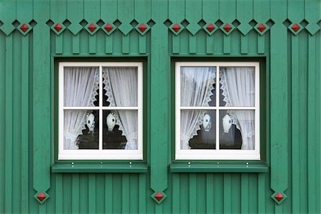 Windows of typical wooden house in Born, Fischland-Darss-Zingst, Coast of the Baltic Sea, Mecklenburg-Western Pomerania, Germany, Europe Stock Photo - Rights-Managed, Code: 700-06892503