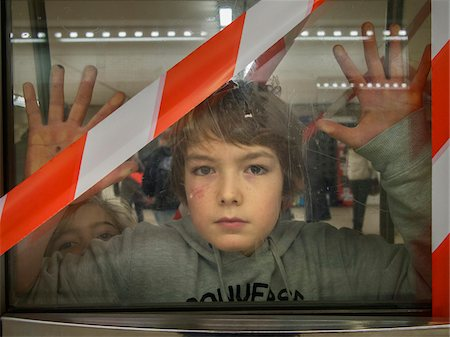 sister - young boy behind blocked door in parisian subway, Paris, France Stock Photo - Rights-Managed, Code: 700-06892582