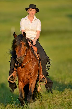 Portrait of woman riding a Connemara stallion on a meadow, Germany Stock Photo - Rights-Managed, Code: 700-06900027