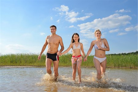 preteen bathing suit - Happy Family Running in Shallow Water of Lake in Summer, Bavaria, Germany Stock Photo - Rights-Managed, Code: 700-06936065