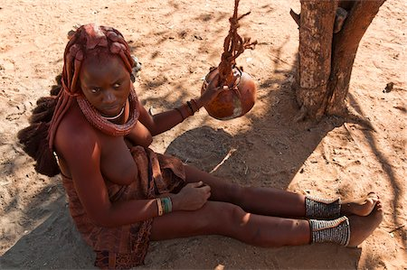 Himba woman making butter in a dried pumpkin, Kaokoveld, Namibia, Africa Stock Photo - Rights-Managed, Code: 700-06936148