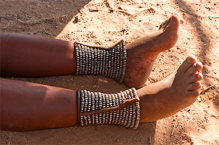 Legs of Himba woman, Kaokoveld, Namibia, Africa Stock Photo - Rights-Managed, Code: 700-06936149