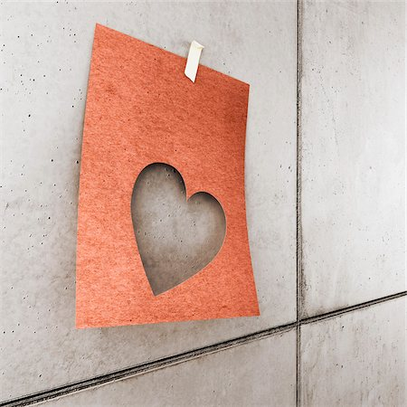 3d-illustraion of a heart shaped paper on concrete wall Stock Photo - Rights-Managed, Code: 700-06936142